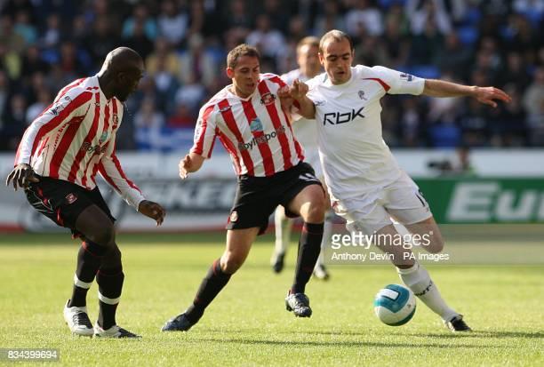 Bolton Wanderers' Gavin McCann and Sunderland's Michael Chopra battle for the ball