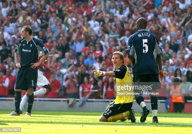 Bolton Wanderers goalkeeper Jussi Jaaskelainen is left dejected after the second Arsenal goal by Francesc Fabregas