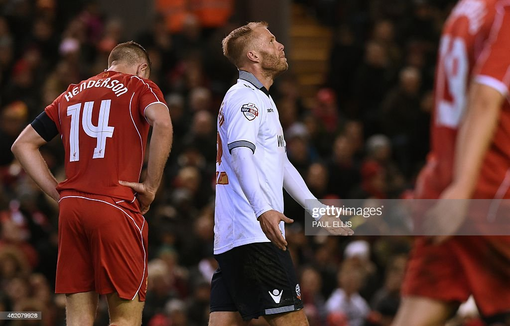 Bolton Wanderers' Icelandic striker <a gi-track='captionPersonalityLinkClicked' href=/galleries/search?phrase=Eidur+Gudjohnsen&family=editorial&specificpeople=171363 ng-click='$event.stopPropagation()'>Eidur Gudjohnsen</a> (C) reacts after missing a chance during the FA Cup fourth round football match between Liverpool and Bolton Wanderers at Anfield in Liverpool, northwest England, on January 24, 2015. USE. No use with unauthorized audio, video, data, fixture lists, club/league logos or live services. Online in-match use limited to 45 images, no video emulation. No use in betting, games or single club/league/player publications. ==