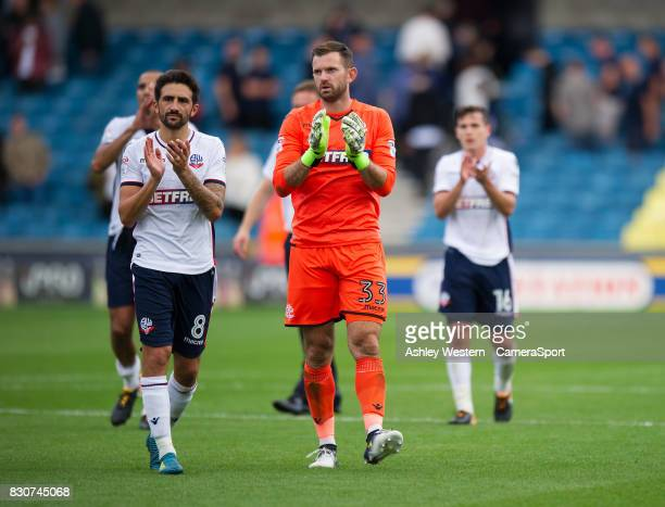 Bolton Wanderers' Jem Karacan and Mark Howard celebrate their point at the Den during the Sky Bet Championship match between Millwall and Bolton...