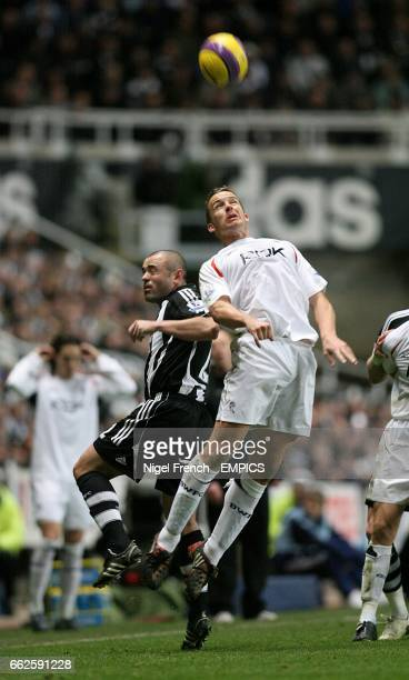 Bolton Wanderers' Kevin Davies and Newcastle United's Stephen Carr battle for the ball in the air