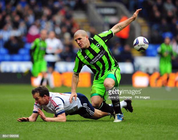 Bolton Wanderers' Kevin Davies is fouled by Brighton and Hove Albion's Adam ElAbd during the npower Football League Championship match at The Reebok...