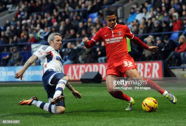 Bolton Wanderers' Kevin McNaughton tackles Charlton Athletic's Cameron Stewart during the Sky Bet Championship match at the Reebok Stadium Bolton