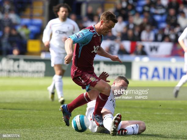 Bolton Wanderers' Kevin Nolan challenges West Ham United's Scott Parker for the ball