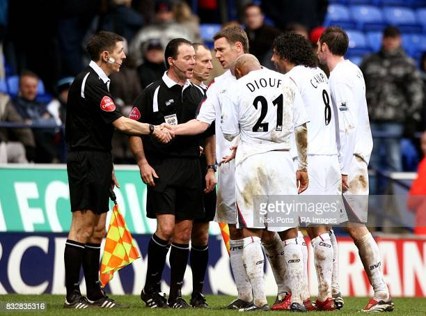 Bolton Wanderers' Kevin Nolan shakes hands with the linesman who ruled a last minute goal for Bolton as offside