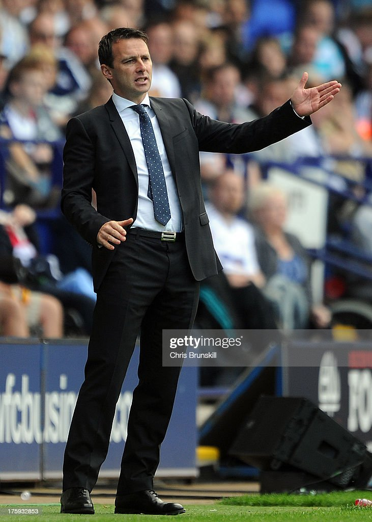 Bolton Wanderers manager <a gi-track='captionPersonalityLinkClicked' href=/galleries/search?phrase=Dougie+Freedman&family=editorial&specificpeople=710974 ng-click='$event.stopPropagation()'>Dougie Freedman</a> gestures on the touchline during the Sky Bet Championship match between Bolton Wanderers and Reading at Reebok Stadium on August 10, 2013 in Bolton, England.