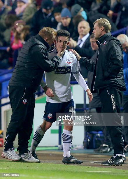 Bolton Wanderers manager Neil Lennon congratulates match winner Bolton Wanderers' Zach Clough as he is substituted