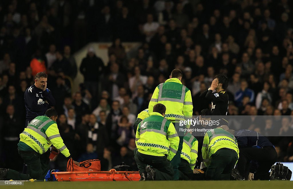 Bolton Wanderers manager Owen Coyle (L) and Ryo Miyaichi are distraught as Fabrice Muamba of Bolton Wanderers receives CPR treatment on the pitch after suddenly collapsing during the FA Cup Sixth Round match between Tottenham Hotspur and Bolton Wanderers at White Hart Lane on March 17, 2012 in London, England. The game was abandoned.