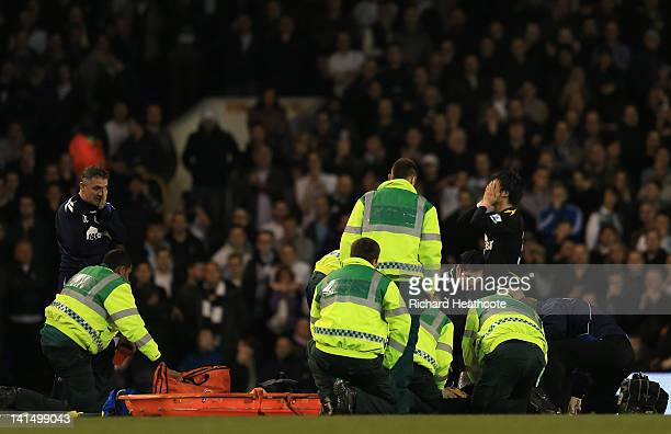 Bolton Wanderers manager Owen Coyle and Ryo Miyaichi are distraught as Fabrice Muamba of Bolton Wanderers receives CPR treatment on the pitch after...