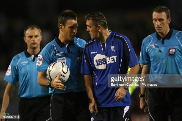 Bolton Wanderers' manager Owen Coyle has words with referee Mark Clattenburg during the third round Carling Cup match at Turf Moor Burnley