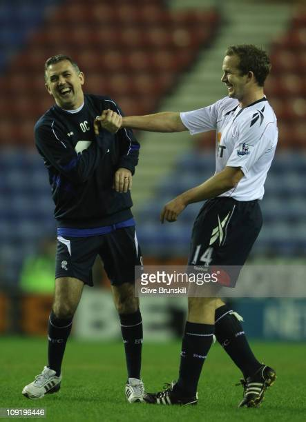 Bolton Wanderers manager Owen Coyle shares a joke with his striker Kevin Davies after his teams 10 victory during the FA Cup sponsored by EON 4th...