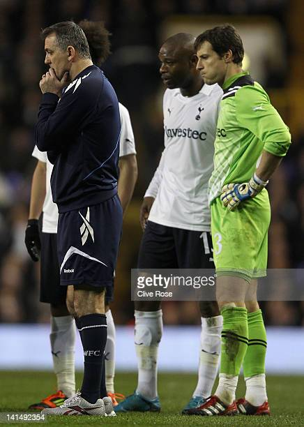 Bolton Wanderers manager Owen Coyle William Gallas and Carlo Cudicini of Tottenham Hotspur look concerned as Fabrice Muamba of Bolton Wanderers...