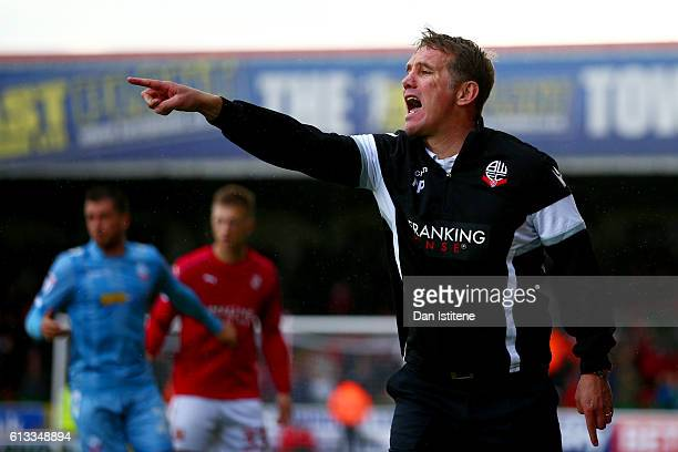 Bolton Wanderers manager Phil Parkinson issues instructions to his players during the Sky Bet League One match between Swindon Town and Bolton...