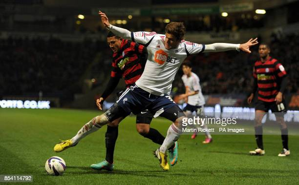 Bolton Wanderers Marcos Alonso battles for the ball with Peterborough United's Nathaniel MendezLaing during the npower Championship match at the...