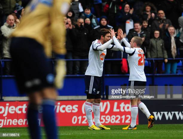 Bolton Wanderers' Marcos Alonso celebrates with Jay Spearing after scoring his side's first goal during the npower Football League Championship match...