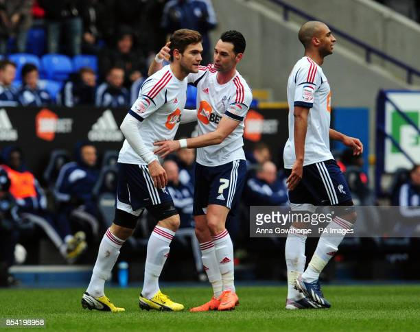 Bolton Wanderers' Marcos Alonso is congratulated by Chris Eagles after scoring his side's first goal during the npower Football League Championship...
