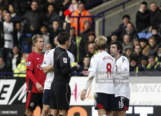 Bolton Wanderers' Mark Davies is shown a red card by referee Mark Clattenburg