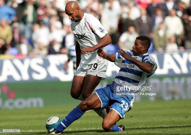 Bolton Wanderers' Nicolas Anelka skips past the challenge of Reading's Ulises De la Cruz