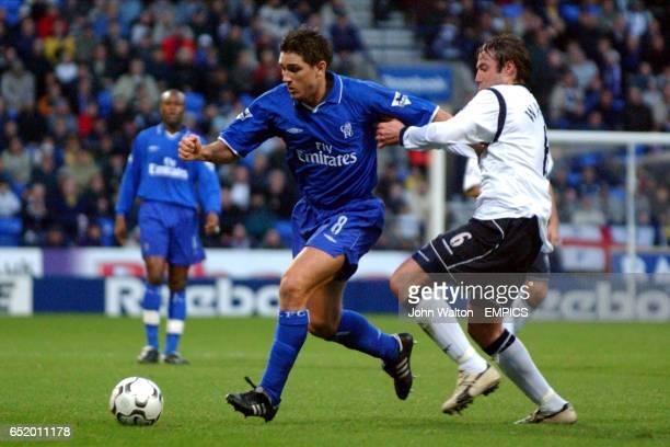 Bolton Wanderers' Paul Warhurst tackles Chelsea's Frank Lampard