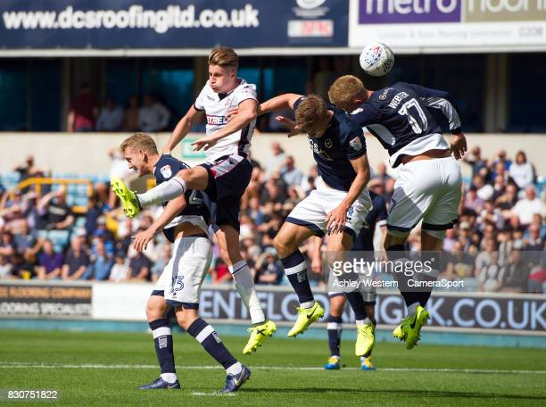 Bolton Wanderers' Reece Burke battles for possession with Millwall's George Saville during the Sky Bet Championship match between Millwall and Bolton...