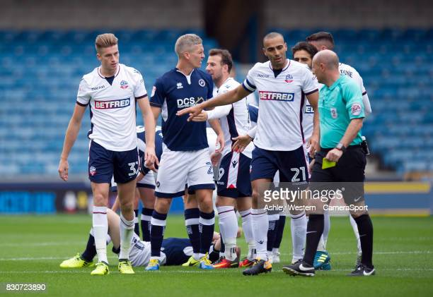 Bolton Wanderers' Reece Burke is shown a yellow card by Referee Andy Davies as Darren Pratley protests during the Sky Bet Championship match between...