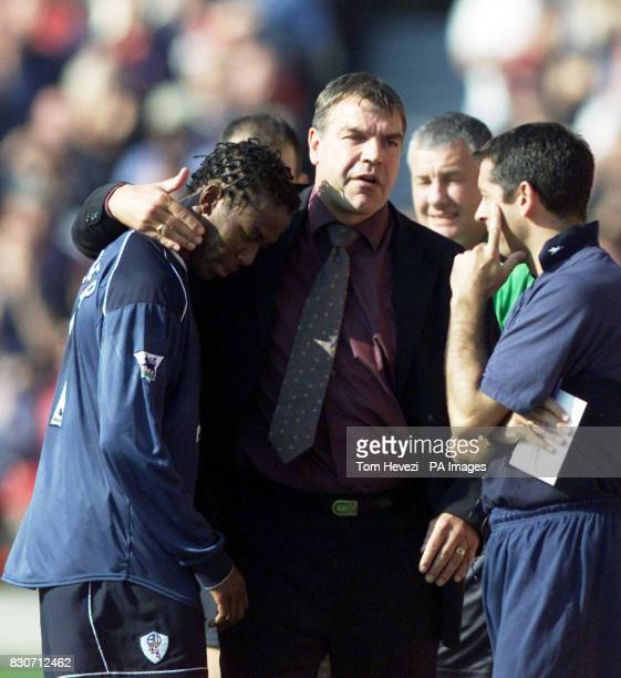 Bolton Wanderers' Ricardo Gardner is consoled by manager Sam Allardyce after being sent off after tugging back Arsenal's Dennis Bergkamp during the...