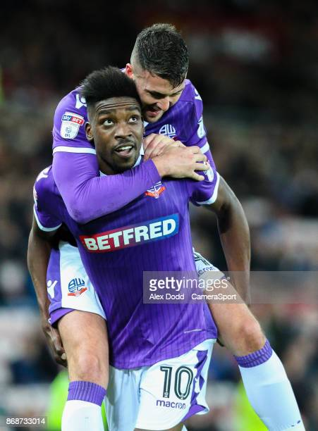 Bolton Wanderers' Sammy Ameobi celebrates scoring his side's first goal with teammate Gary Madine during the Sky Bet Championship match between...
