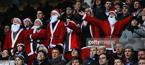 Bolton Wanderers supporters dressed as Santa Claus watch from the stands during the Barclays Premier League match between Sunderland and Bolton...