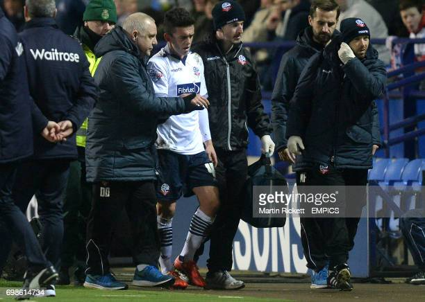Bolton Wanderers Zach Clough leaves the pitch with an injury during the game against Reading