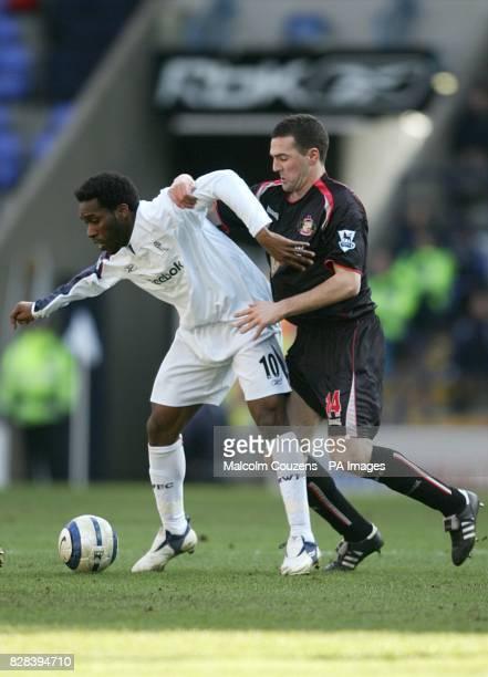 Bolton Wanderers's JayJay Okocha tussles with Sunderland's Tommy Miller
