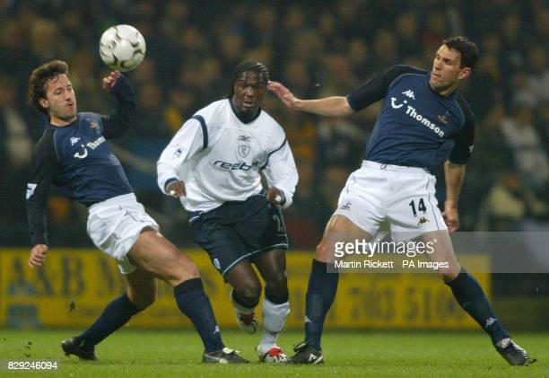 Bolton Wanders's Bernard Mendy is challenged by Tottenham Hotspur's Mauricio Taricco and Gus Poyet during the Barclaycard Premiership match at...
