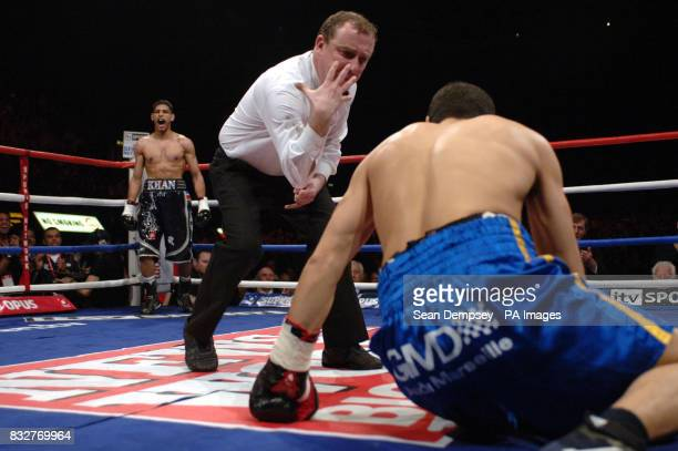 Bolton's Amir Khan celebrates his knock down of France's Mohammed Medjani during the LightWelterweight fight at the Wembley Arena London