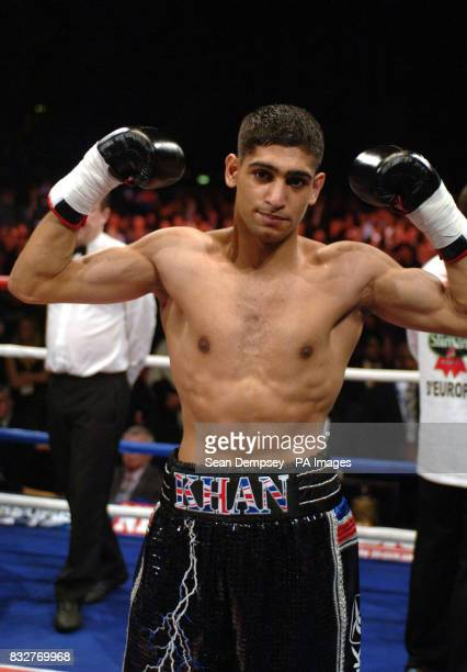 Bolton's Amir Khan celebrates his victory against France's Mohammed Medjani after the LightWelterweight fight at the Wembley Arena London