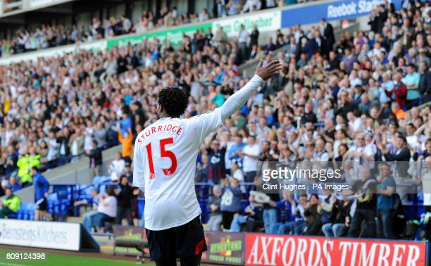 Bolton's Daniel Sturridge salutes the fans after he scores the third goal of the game during the Barclays Premier League match at the Reebok Stadium...