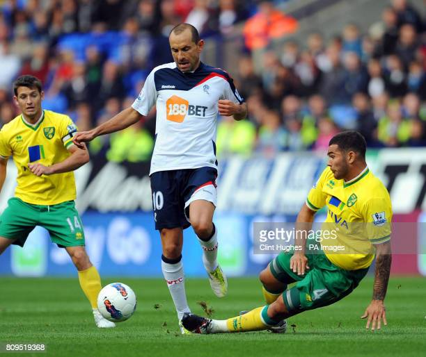Bolton's Martin Petrov is tackled by Norwich's Bradley Johnson during the Barclays Premier League match at the Reebok Stadium Bolton