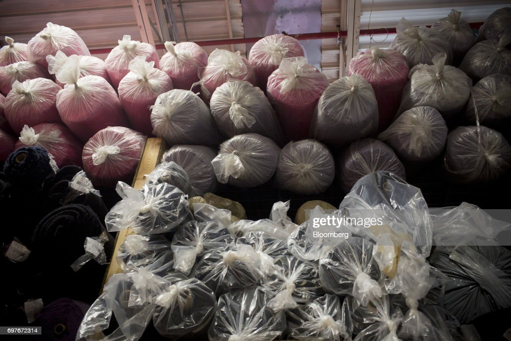 Bolts of fabric sit in a storage area at the WS & Co. production facility in Toronto, Ontario, Canada, on Friday, June 9, 2017. Canada Day celebrates the anniversary of the creation of the Canadian Federation through the North America Act on July 1. Photographer: Brent Lewin/Bloomberg via Getty Images