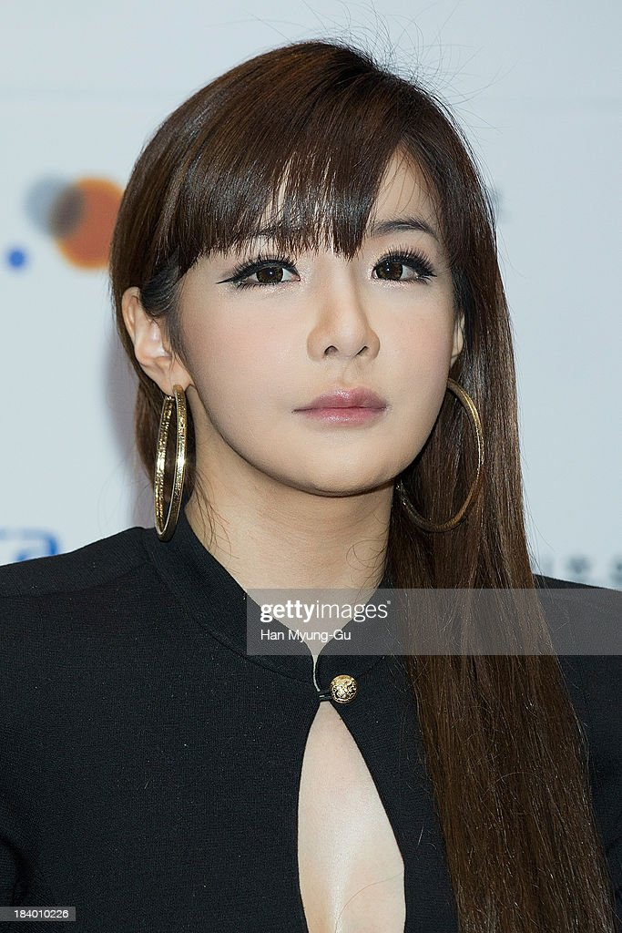 Bom of South Korean girl group 2NE1 attends the press conference to announce the 2NE1 being appointed as honorary ambassador for 2013 KBEE (Korea Brand and Entertainment Expo) in London at Kotra on October 10, 2013 in Seoul, South Korea.
