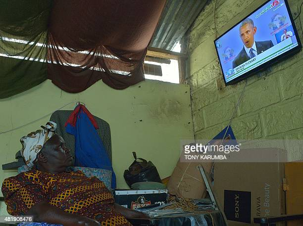 1998 bomb attack survivor Mary Nyokabi as she watches on a television set in a restaurant near her home in the suburb of OngataRongai in Nairobi US...
