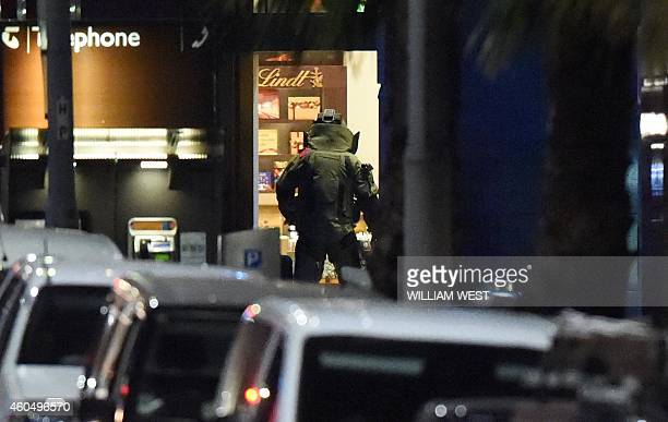 A bomb disposal expert enters the cafe after a hostage siege in the central business district of Sydney on December 16 2014 Police stormed the Sydney...