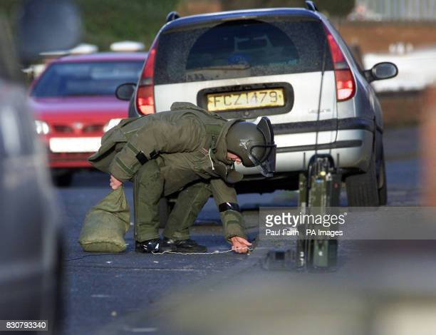A Bomb disposal expert prepares to defuse a pipe bomb found at the home of Sinn Fein Belfast Councillor Alex Maskey the unexploded device almost...