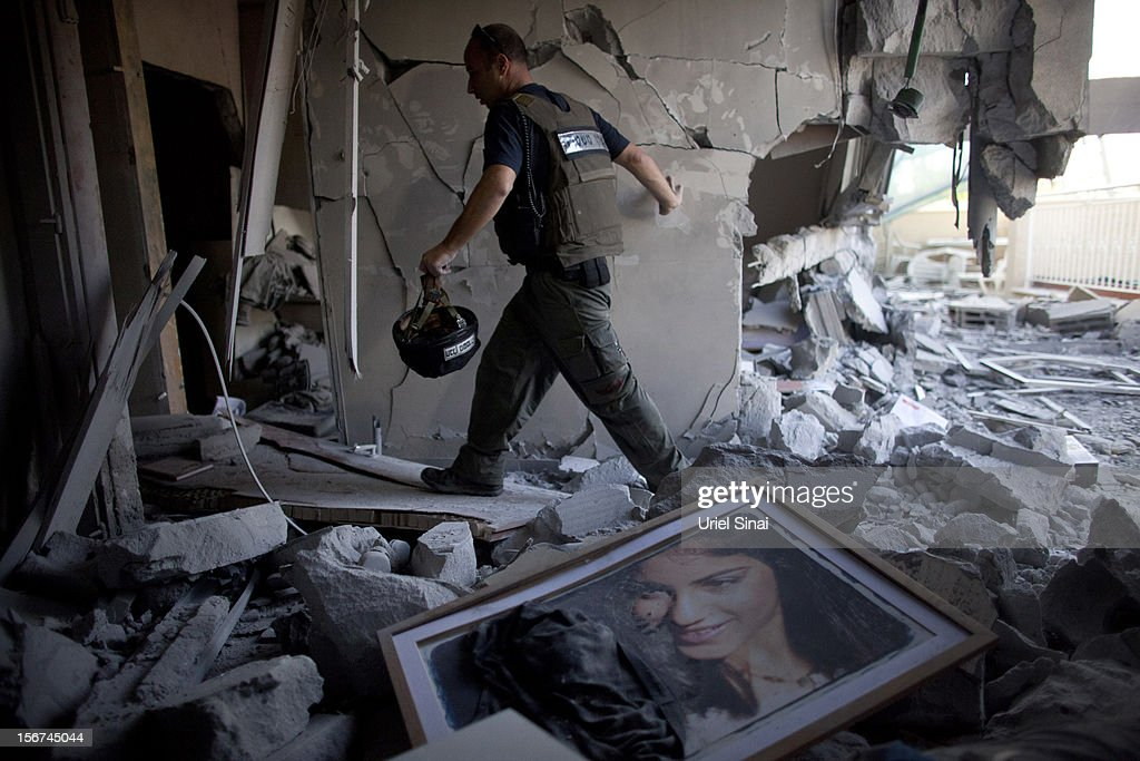 A bomb disposal officer at a house after it was hit by a rocket fired from the Gaza Strip on November 20, 2012 in Beersheba, Israel. Hamas militants and Israel are continuing talks aimed at a ceasefire as the death toll in Gaza reaches over 100 with three Israelis also having been killed by rockets fired by Palestinian militants.