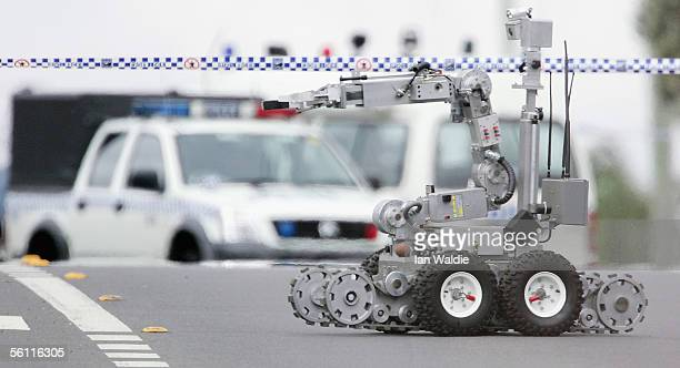 A bomb disposal robot rolls down Wilson Street in Green Valley November 8 2005 in Sydney Australia Sixteen people have been arrested in Sydney and...