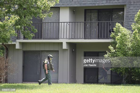 Bomb Disposal Unit checks for explosives around the apartment building where shooting suspect Omar Mateen is believed to have lived on June 12 2016...