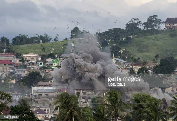 TOPSHOT A bomb explodes after being dropped on an Islamist militants' hideout in Marawi on the southern Philippine island of Mindanao on June 9 2017...