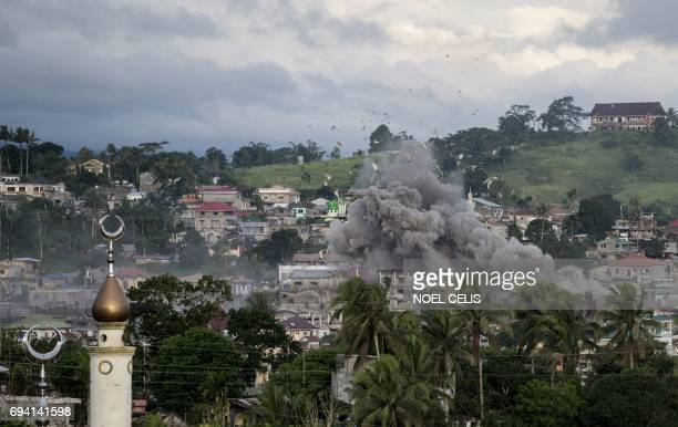 A bomb explodes after being dropped on an Islamist militants' hideout in Marawi on the southern Philippine island of Mindanao on June 9 2017 More...