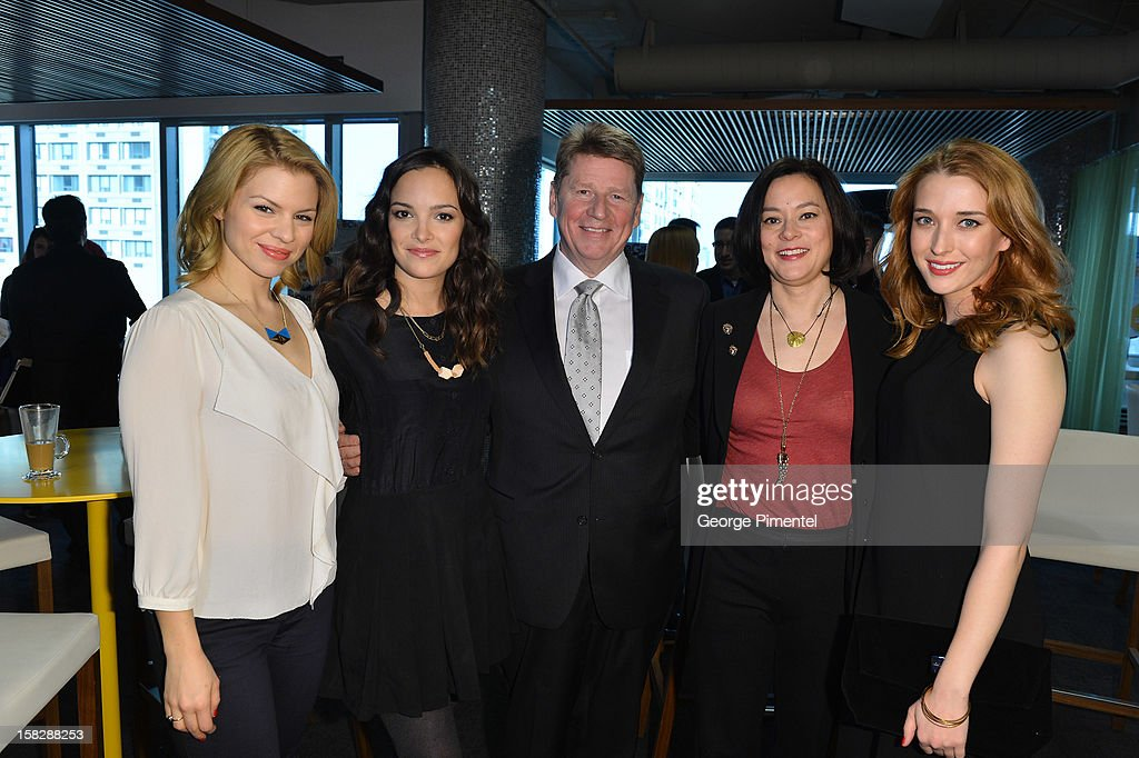 'Bomb Girls' cast Ali Liebert Jodi Balfour, Meg Tilly and Charlotte Hegele pose with Shaw Media president Paul Robertson at the Shaw Media Press Conference held at the Shaw Media Building on December 12, 2012 in Toronto, Canada.