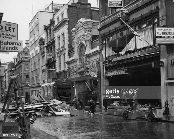 Bomb Squad officers search the wreckage of the Gieves tailor's shop the day after an IRA bomb exploded in the shop on Old Bond Street London 28th...