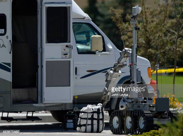Bomb Squad robot pokes around a suspicious package outside an rv where a unidentified reference to the package Aurora PD and Aurora Fire responded to...