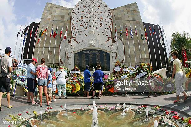Bomb vicitims family pay their resepects during the memorial service to mark the annnivesary of the 2002 bombings at the Bomb Memorial at Kuta on...