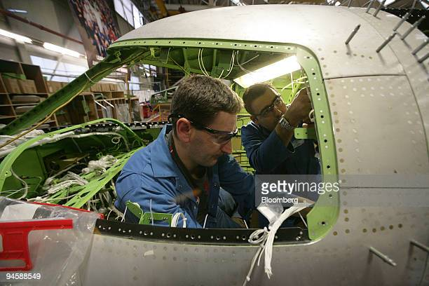 Bombardier aircraft electricians work inside a Learjet 40 XR aircraft on the production line in Belfast Northern Ireland on Monday Jan 21 2008...